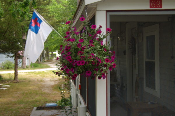 Cottage With Flag